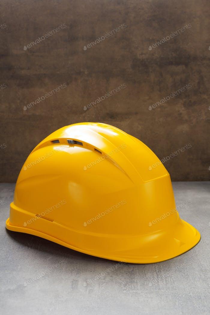 construction helmet on stone concrete background