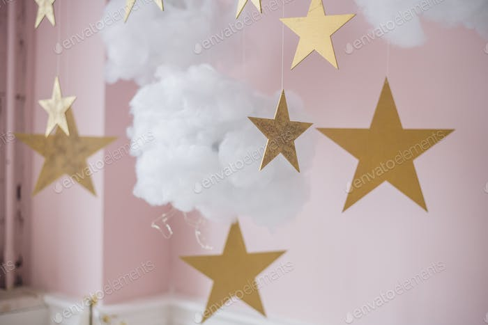 Cotton wadding clouds with stars on pink background