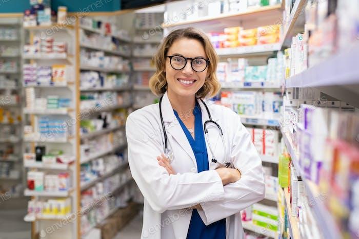 Happy smiling pharmacist in drugstore