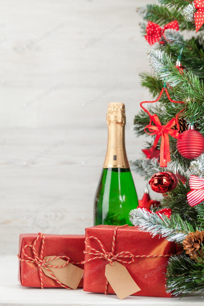 Christmas card with decorated fir tree and champagne