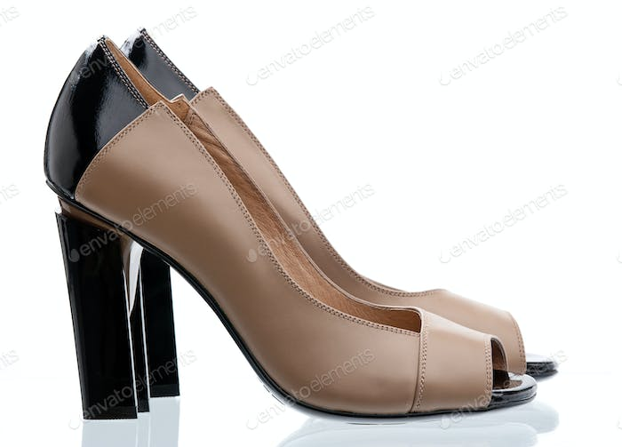 Pair of open-toe women shoes isolated over white