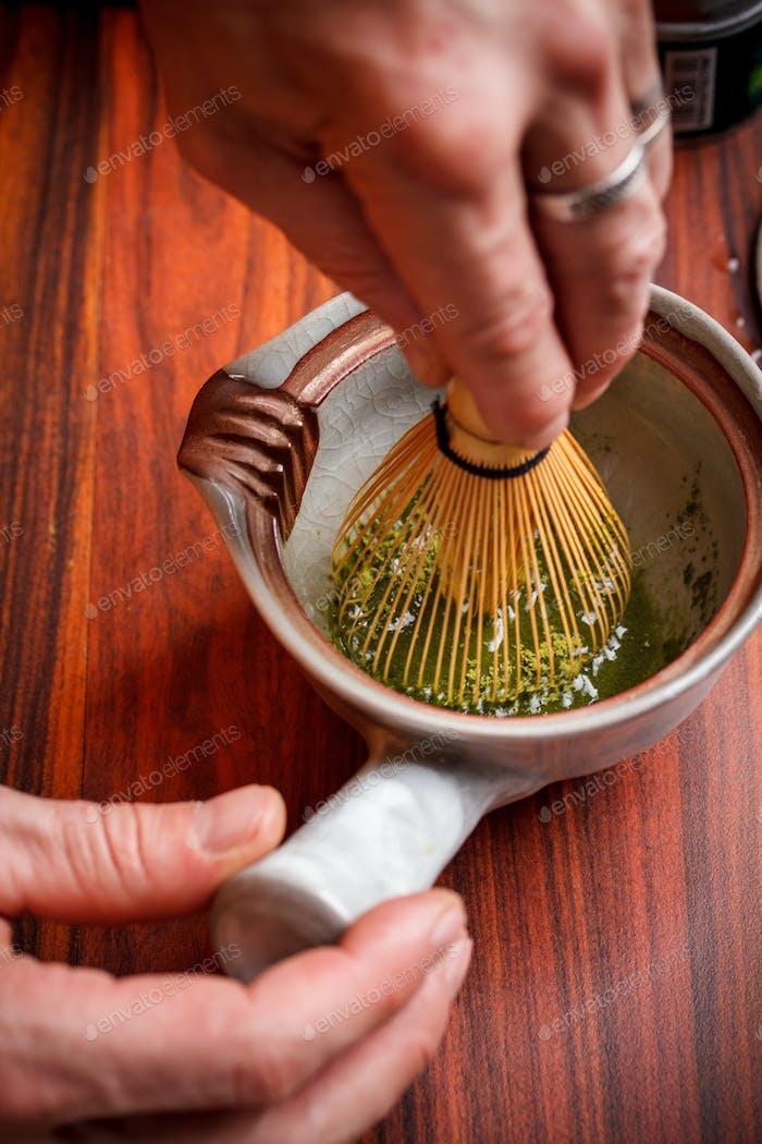 Stirring matcha tea