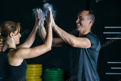 Sporty couple clapping hands photo by Click_and_Photo on