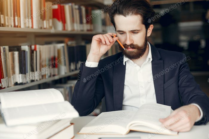 Handsome guy study at the library