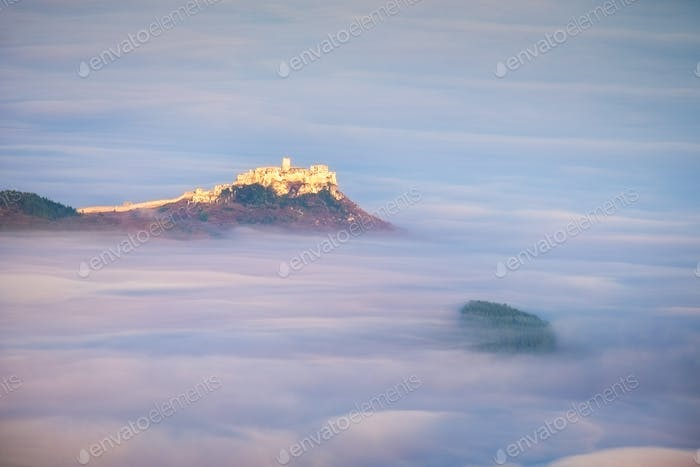 Scenic view of Spis castle at sunrise above clouds, Slovakia
