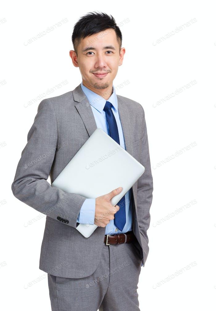 Asian businessman holding laptop