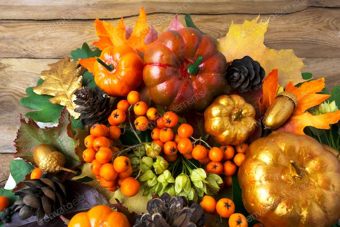 Thanksgiving greenery with golden pumpkins and acorns
