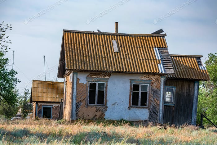 Abandoned old house in russian countryside in summer