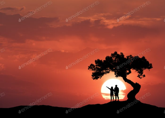 People under the crooked tree on the background of sun