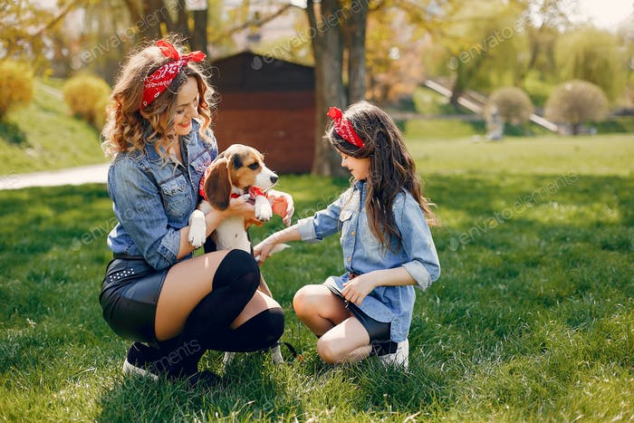 Cute and stylish family in a spring park
