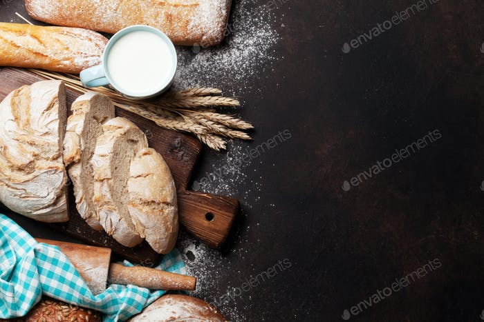 Various crusty bread and cup of milk