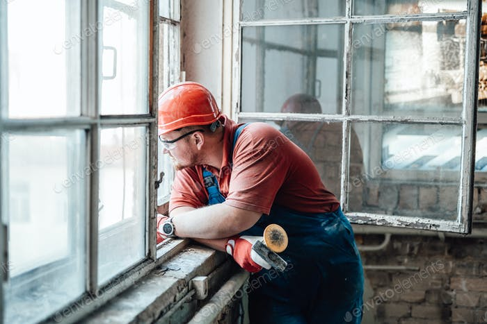 Tired worker looks out of the window