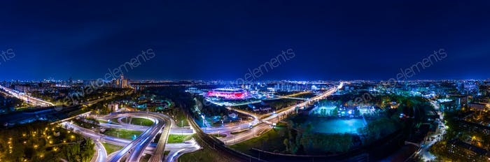 Night Aerial view panorama of a freeway intersection traffic tra
