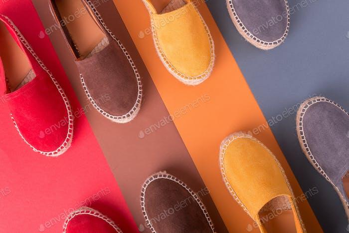 Four pair of espadrilles on multicolor