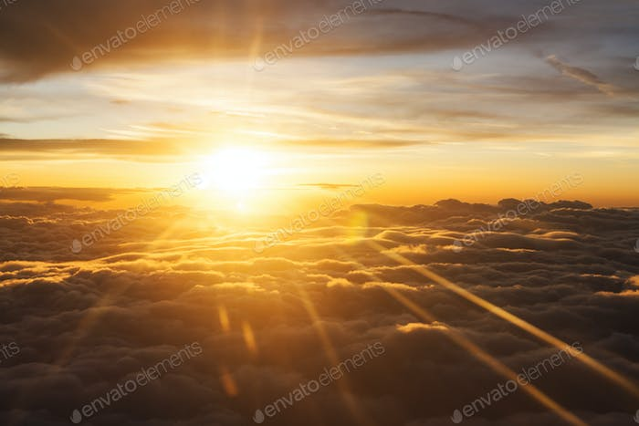 Orange Sunrise Betwen Clouds