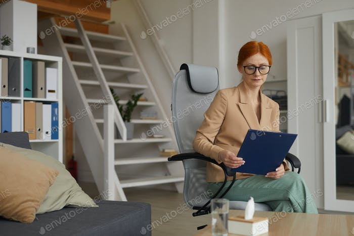 Businesswoman sitting at office