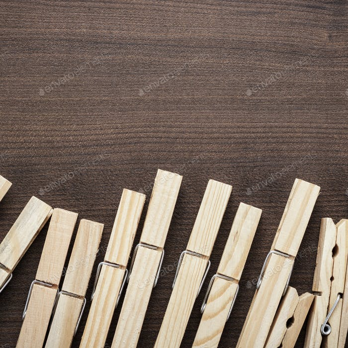Thumbnail for Wooden Clothes Pegs On The Table