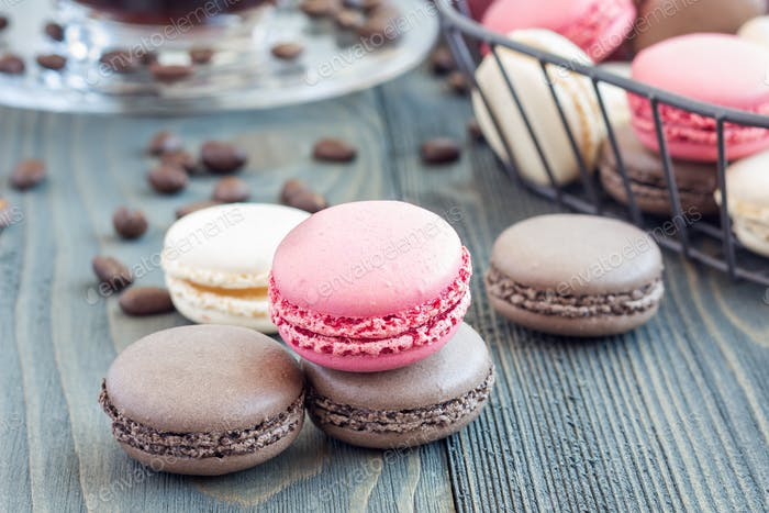 Different kinds of colorful french dessert macaron, served with coffee, horizontal