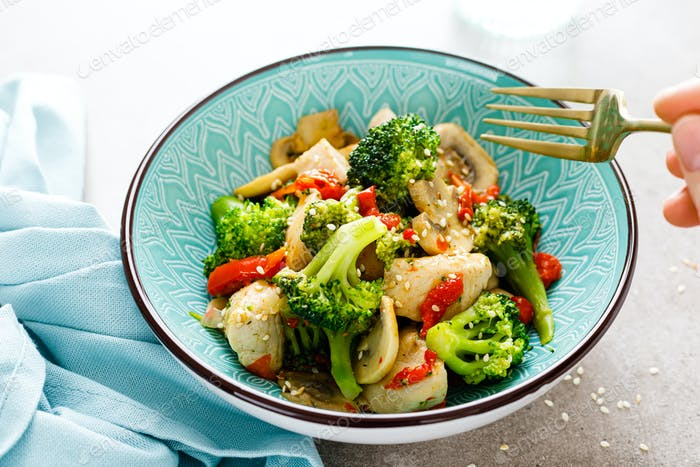 Chicken stir fry with vegetables and mushrooms
