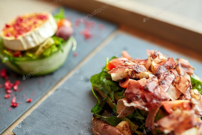 prosciutto ham salad on stone plate at restaurant