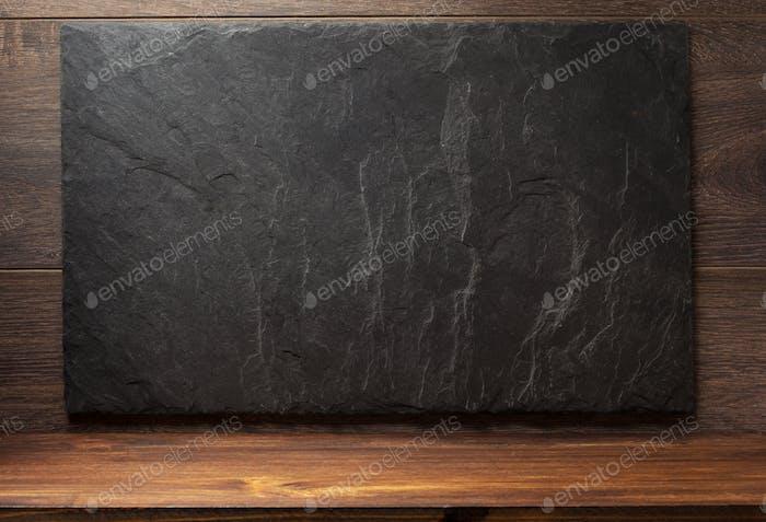 black slate stone on wood