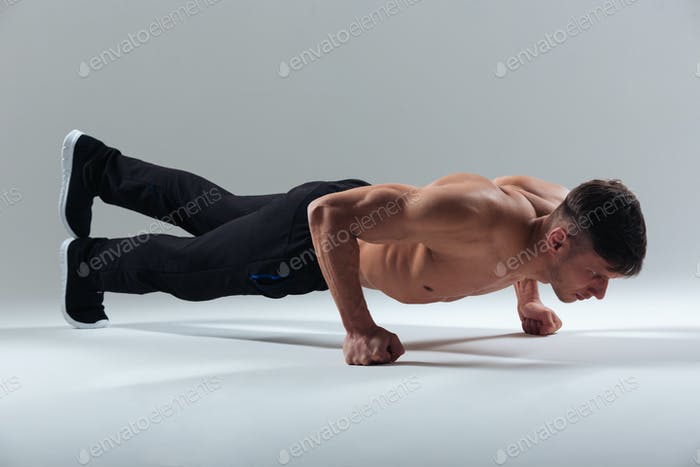 Fitness man doing plank exercise