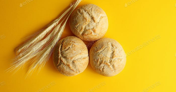 Golden buns of bread and wheat