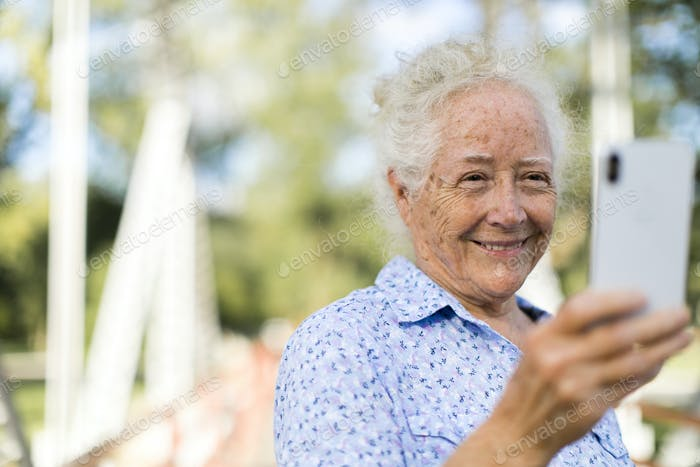 Sweet senior woman taking a selfie