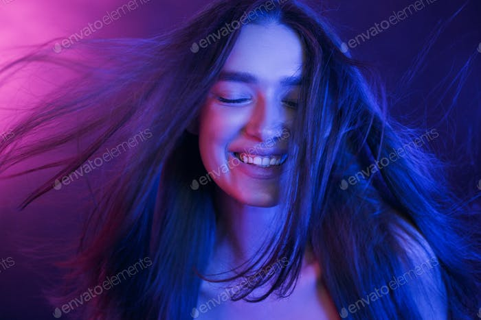 Woman Colorful Portrait. Girl playing with hair