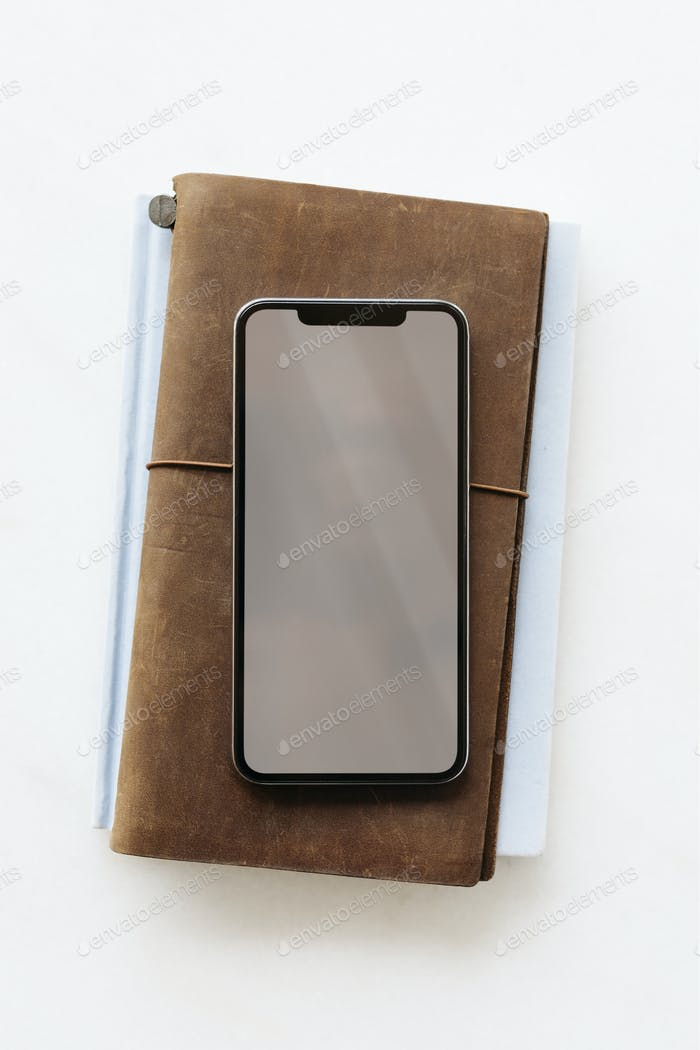 Phone on a leather diary