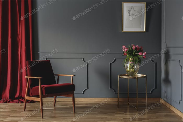Simple waiting room interior with a single red armchair standing
