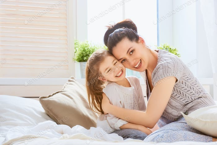 girl and her mother enjoying sunny morning