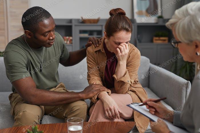 Depressed woman visiting psychologist