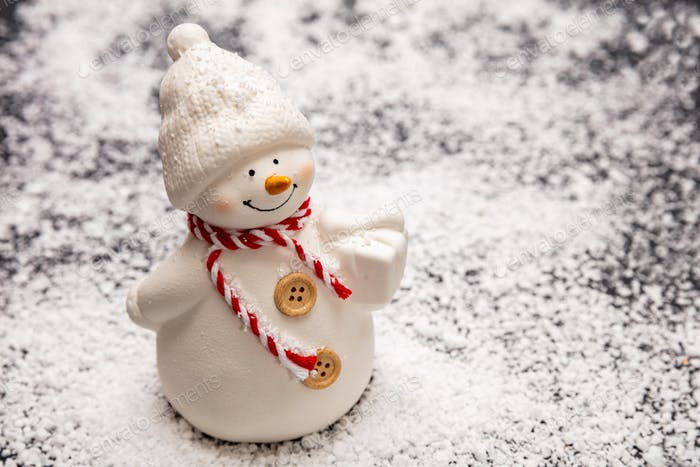 Snowman on snowy background, copy space
