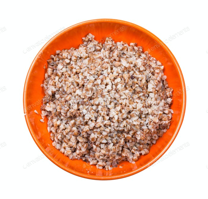top view of buckwheat porridge in bowl isolated