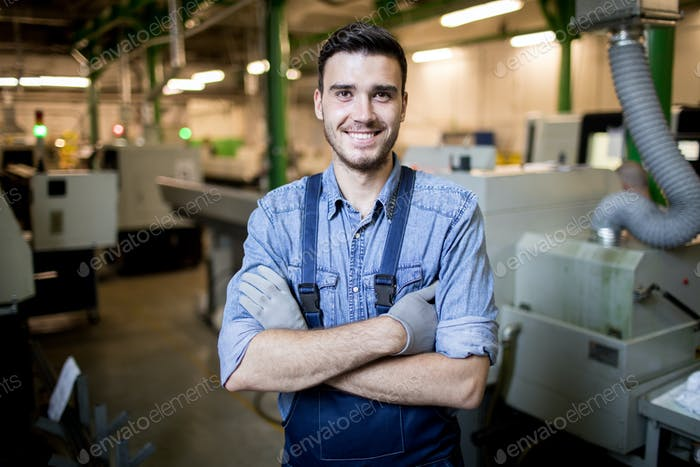 Young engineer standing in factory