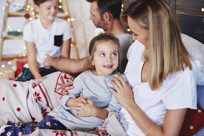 Shot of happy family in christmas morning