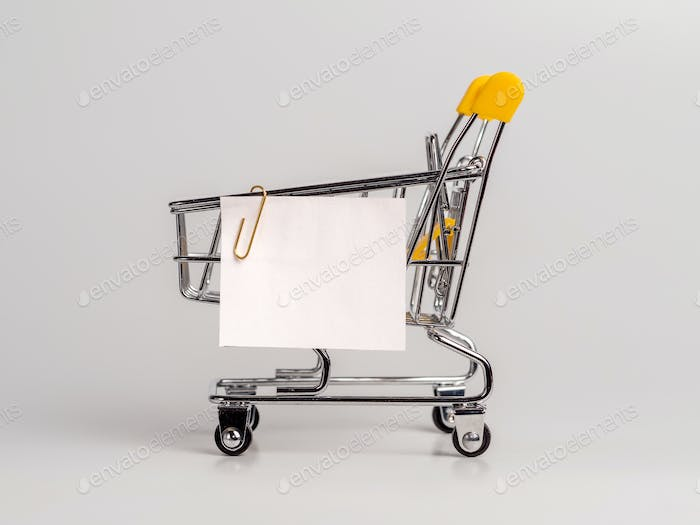 Shopping cart and white paper note list