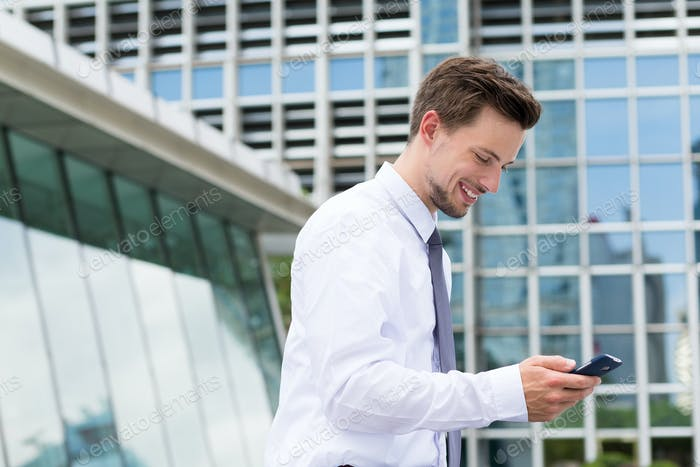 Young businessman use of the mobile phone