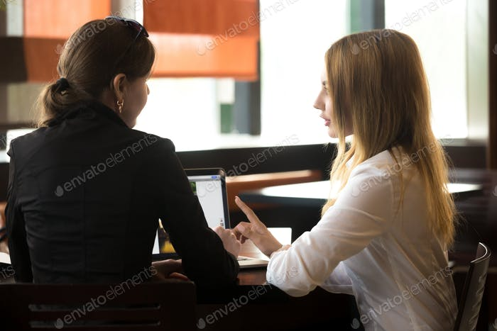 Business meeting in cafe