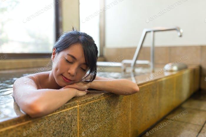 Woman enjoy onsen