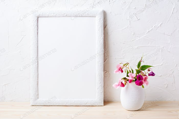 White frame mockup with pink flowers in flowerpot