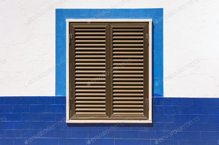 Closed window shutters of an mediterranean house