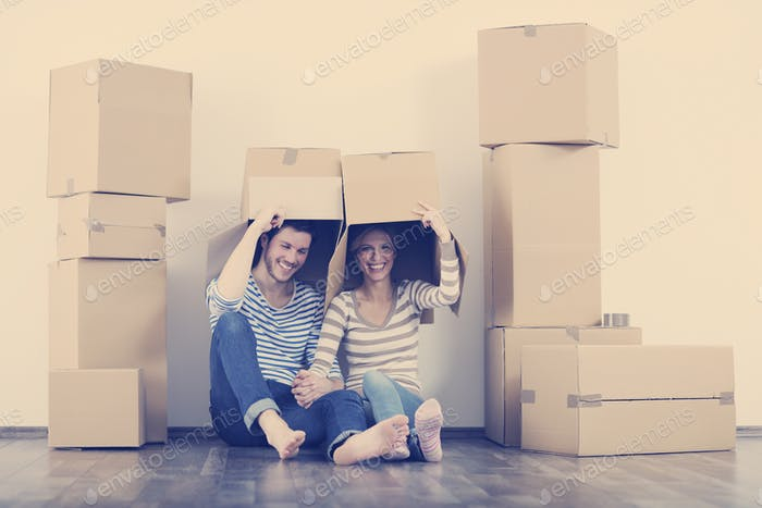 Young couple moving in new home