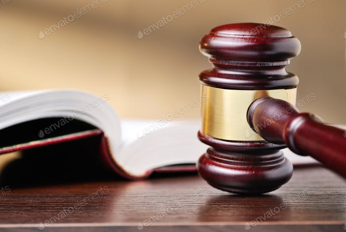 Judges wooden gavel and law book