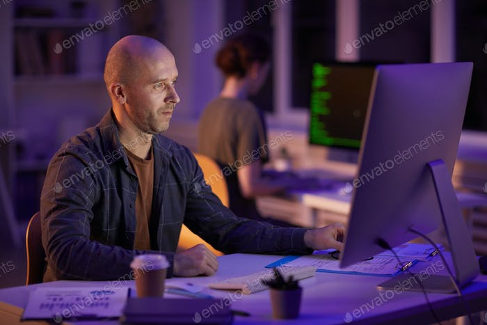 Caucasian Man Working On Computer