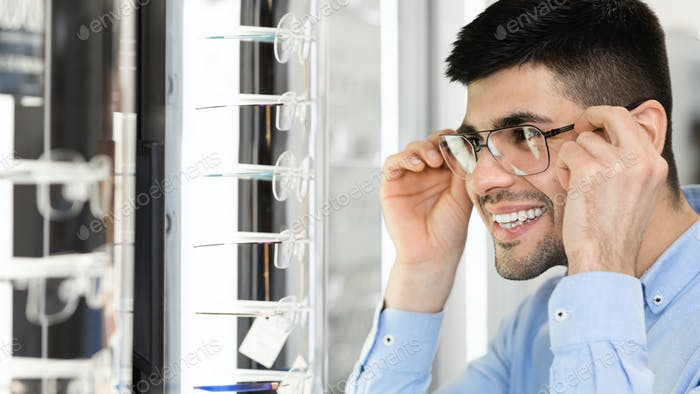 Portrait of smiling young guy wearing spectacles