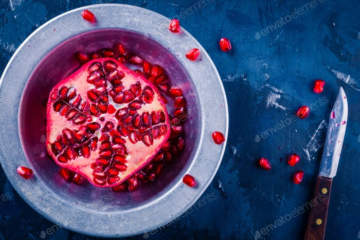 bright juicy ripe pomegranate with seeds in a bowl