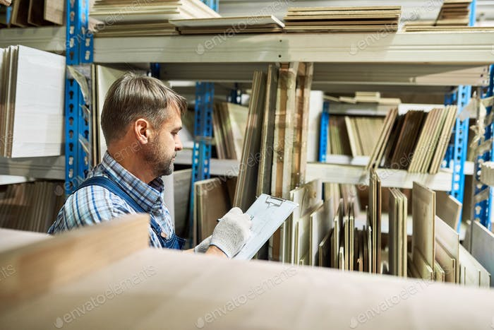 Warehouse Manager Doing Stock Review