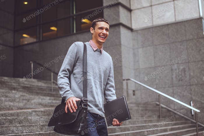 Happy man on stairs